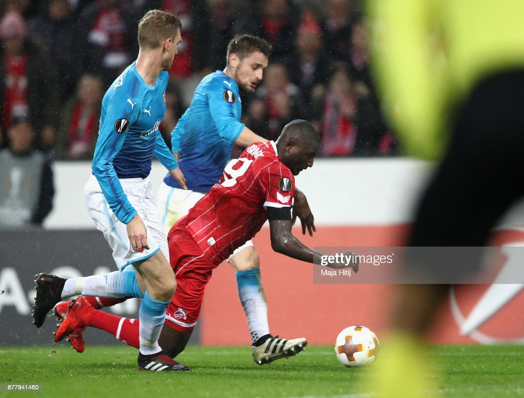 Sehrou Guirassy of FC Koeln falls in the penalty box during the UEFA Europa League group H match between 1. FC Koeln and Arsenal FC at RheinEnergieStadion on November 23, 2017 in Cologne, Germany.