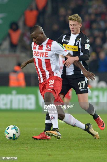 Sehrou Guirassy of Koeln and Mickael Cuisance of Moenchengladbach battle for the ball during the Bundesliga match between 1 FC Koeln and Borussia...