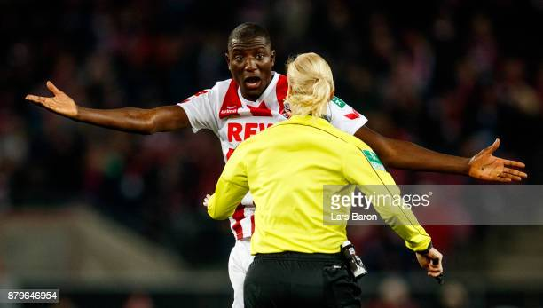 Sehrou Guirassy of Koeln gestures to referee Bibiana Steinhaus during the Bundesliga match between 1 FC Koeln and Hertha BSC at RheinEnergieStadion...