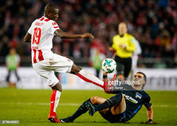 Sehrou Guirassy of Koeln is challenged by Karim Rekik of Berlin during the Bundesliga match between 1 FC Koeln and Hertha BSC at RheinEnergieStadion...