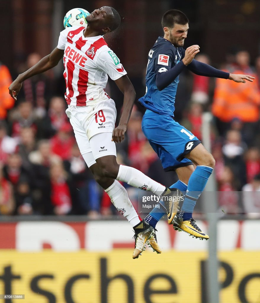 Sehrou Guirassy (L) of Koeln jumps for a header with Florian Grillitsch of Hoffenheim during the Bundesliga match between 1. FC Koeln and TSG 1899 Hoffenheim at RheinEnergieStadion on November 5, 2017 in Cologne, Germany.