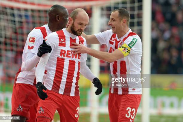 Sehrou Guirassy of Koeln Konstantin Rausch of Koeln and Matthias Lehmann of Koeln celebrate their team`s third goal during the Bundesliga match...