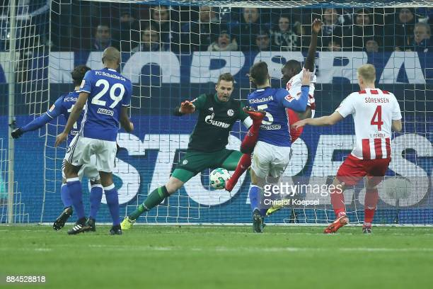 Sehrou Guirassy of Koeln scores a goal past goalkeeper Ralf Faehrmann of Schalke to make it 11 during the Bundesliga match between FC Schalke 04 and...