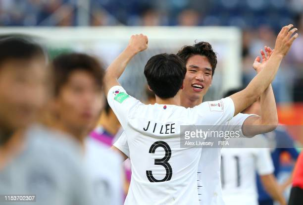 Sehun Oh and Jaeik Lee of Korea Republic celebrate victory after the 2019 FIFA U20 World Cup Round of 16 match between Japan and Korea Republic at...