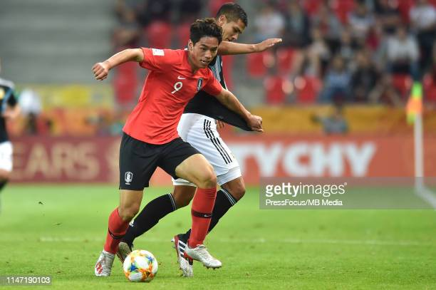 Sehun Oh of Korea Republic and Maximiliano Centurio of Argentina compete for the ball during the FIFA U20 World Cup match between Korea Republic and...