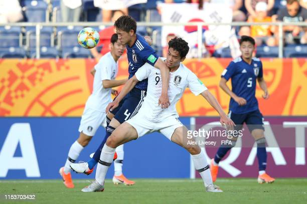 Sehun Oh of Korea Republic battles for possession with Ayumu Seko of Japan during the 2019 FIFA U20 World Cup Round of 16 match between Japan and...