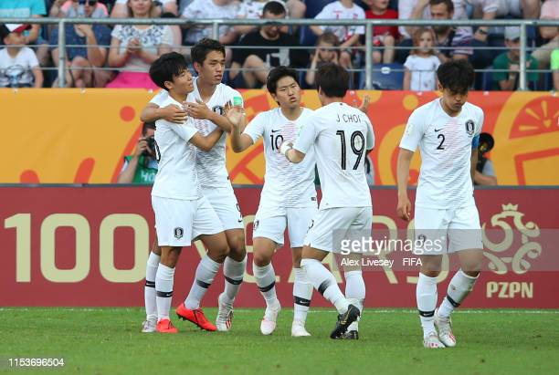 Sehun Oh of Korea Republic celebrates after scoring his team's first goal with team mates during the 2019 FIFA U20 World Cup Round of 16 match...
