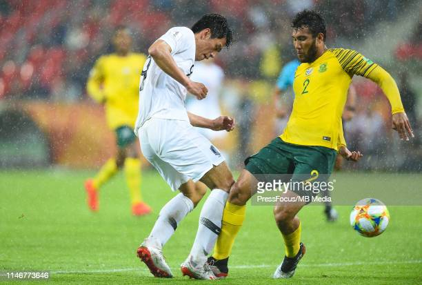 Sehun Oh of Korea Republic competes with Keenan Abrahams of South Africa during the FIFA U20 World Cup match between South Africa and Korea Republic...