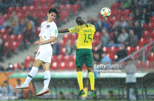 Sehun Oh of Korea Republic competes with Sipheihle Mkhize of South Africa during the FIFA U20 World Cup match between South Africa and Korea Republic...