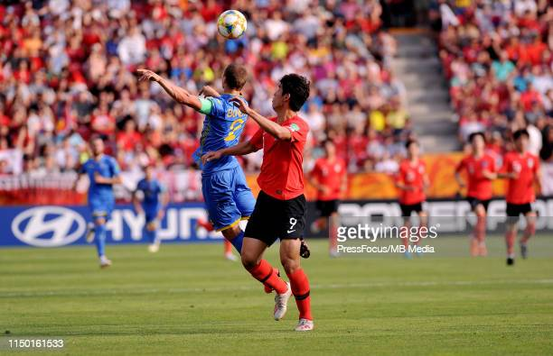 Sehun Oh of Korea Republic competes with Valerii Bondar of Ukraine during the FIFA U20 World Cup match between Ukraine and Korea Republic on June 15...