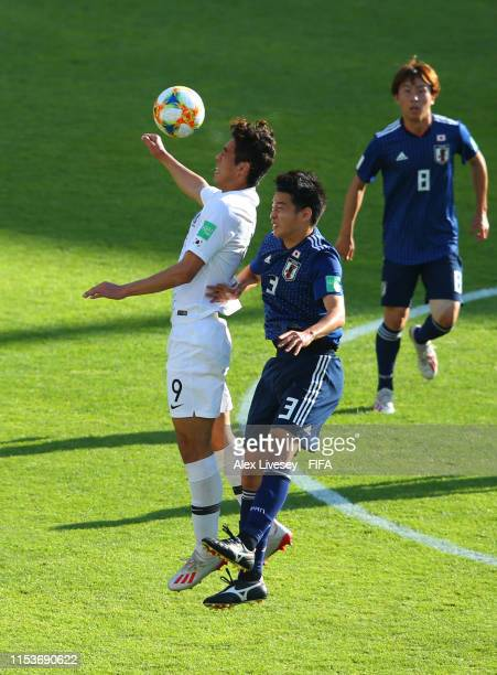 Sehun Oh of Korea Republic jumps for the ball with Yuki Kobayashi of Japan during the 2019 FIFA U20 World Cup Round of 16 match between Japan and...