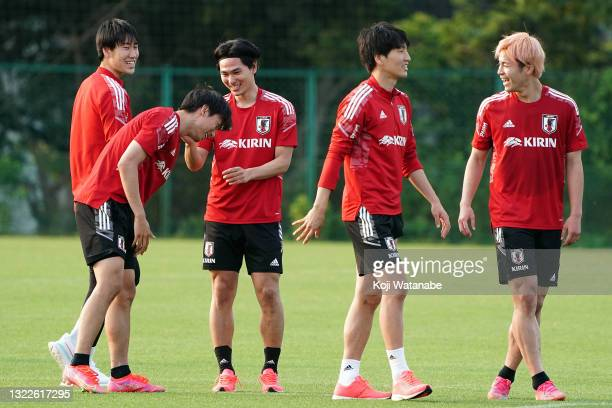 Sei Muroya and Daichi Kamada and Takumi Minamino of Japan look on during the Japan training session on June 08, 2021 in Suita, Osaka, Japan.