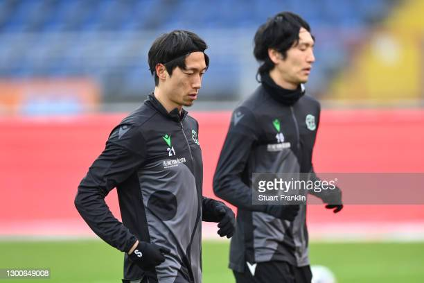 Sei Muroya and Genki Haraguchi of Hannover 96 warm up prior to the Second Bundesliga match between Eintracht Braunschweig and Hannover 96 at...