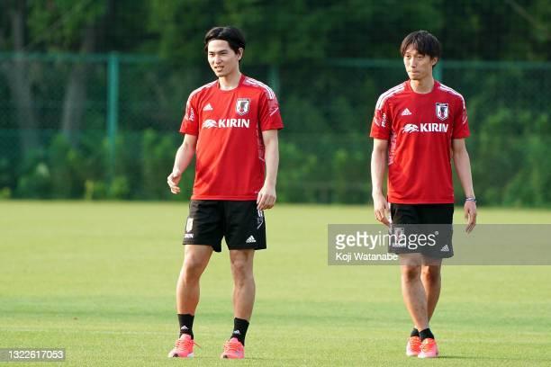 Sei Muroya and Takumi Minamino of Japan look on during the Japan training session on June 08, 2021 in Suita, Osaka, Japan.