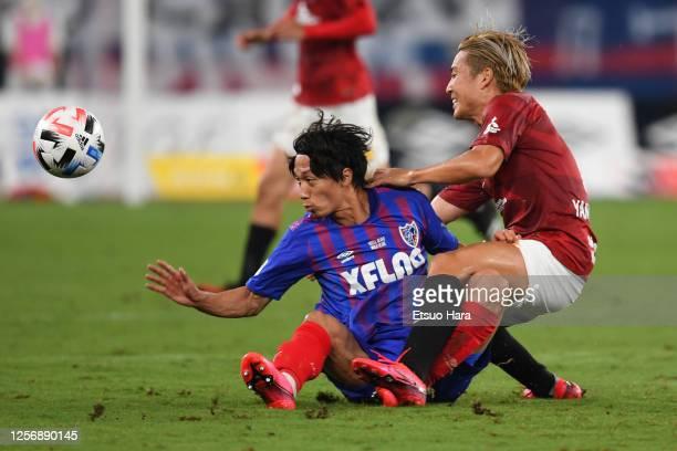 Sei Muroya of FC Tokyo and Ryosuke Yamanaka of Urawa Red Diamonds compete for the ball during the J.League Meiji Yasuda J1 match between FC Tokyo and...
