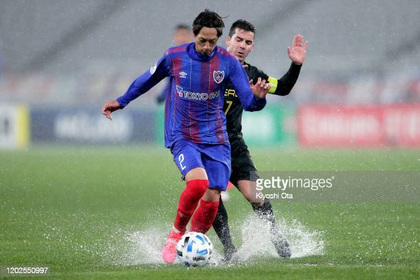 Sei Muroya of FC Tokyo competes for the ball against Bienvenido Maranon of Ceres-Negros during the AFC Champions League play off between FC Tokyo and...
