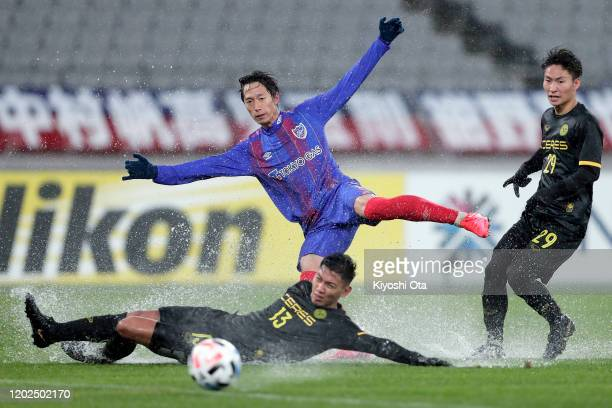 Sei Muroya of FC Tokyo in action against Dennis Villanueva and Hikaru Minegishi of Ceres-Negros during the AFC Champions League play off between FC...