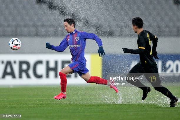 Sei Muroya of FC Tokyo in action against Hikaru Minegishi of Ceres-Negros during the AFC Champions League play off between FC Tokyo and Ceres-Negros...