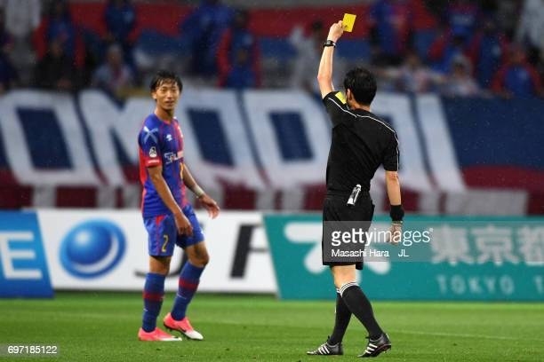 Sei Muroya of FC Tokyo is shown a yellow card by referee Hiroyuki Kimura during the JLeague J1 match between FC Tokyo and Yokohama FMarinos at...