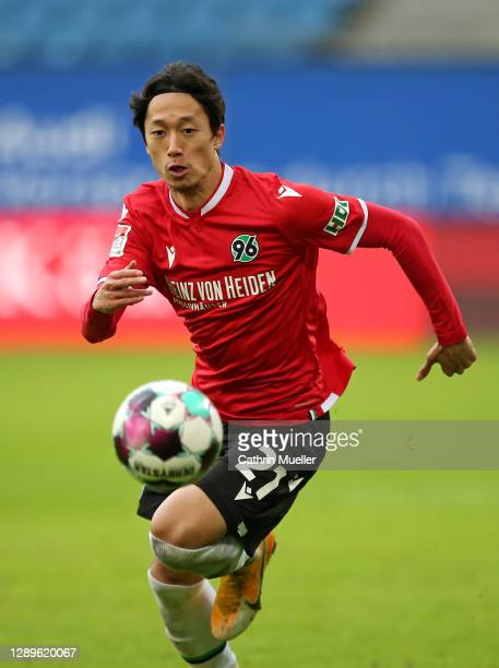 Sei Muroya of Hannover 96 runs with the ball during the Second Bundesliga match between Hamburger SV and Hannover 96 at Volksparkstadion on December...