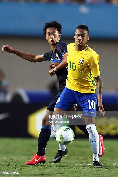 Sei Muroya of Japan and Neymar of Brazil compete for the ball during the international friendly match between Japan and Brazil at the Estadio Serra...