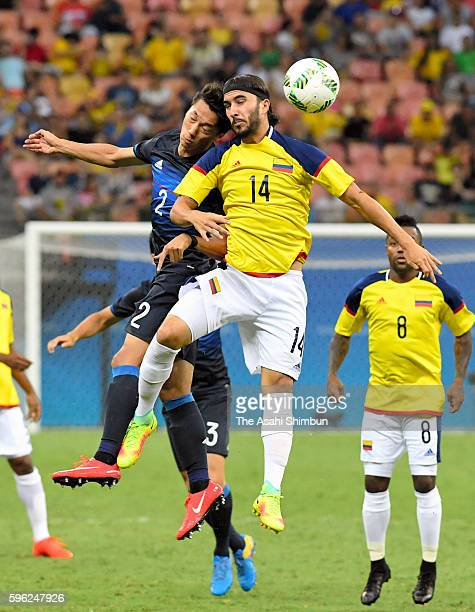 Sei Muroya of Japan and Sebastian Perez of Colombia compete for the ball during 2016 Summer Olympics match between Japan and Colombia at Arena...