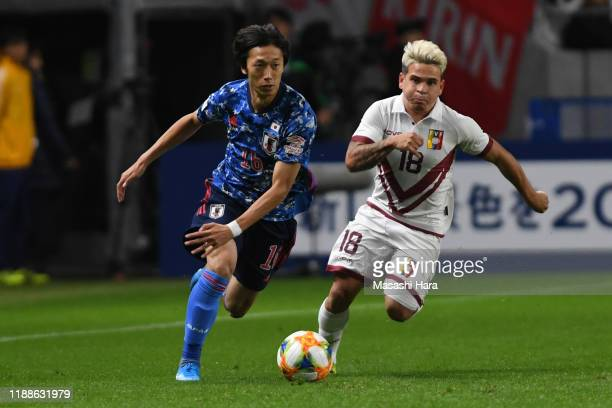 Sei Muroya of Japan and Yeferson Soteldo of Venezuela compete for the ball during the international friendly match between Japan and Venezuela at the...