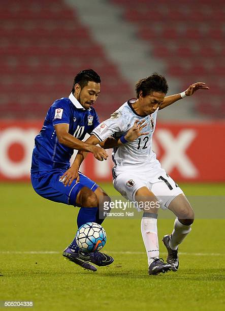 Sei Muroya of Japan battles for the ball with Pakorn Panrmpak of Thailand during the AFC U23 Championship Group B match between Thailand and Japan at...