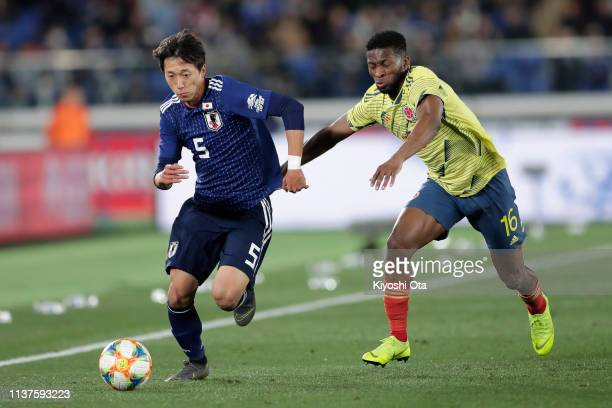 Sei Muroya of Japan in action against Jefferson Lerma of Colombia during the international friendly match between Japan and Colombia at Nissan...