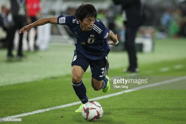 Sei Muroya of Japan in action during the AFC Asian Cup Group F match between Japan and Uzbekistsn at Khalifa Bin Zayed Stadium on January 17, 2019 in...