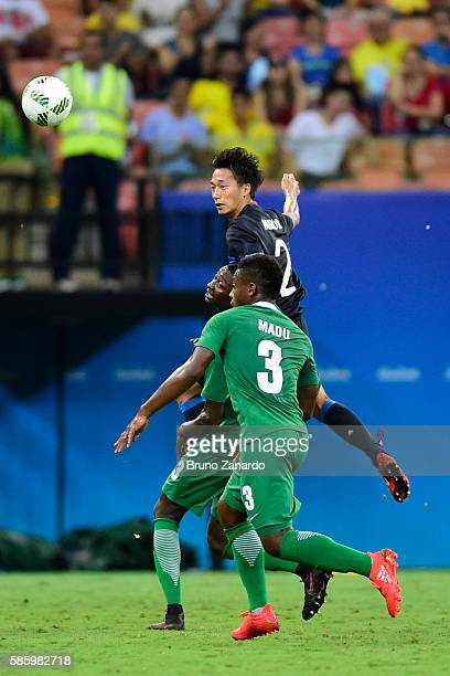 Sei Muroya player of Japan battles for the ball with Kingsley Madu player of Nigeriaduring 2016 Summer Olympics match between Japan and Nigeria at...