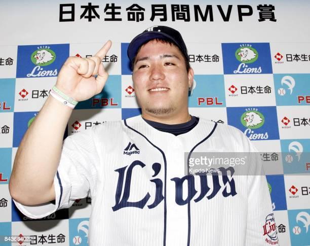 Seibu Lions first baseman Hotaka Yamakawa poses for photos at MetLife Dome in Tokorozawa Saitama Prefecture on Sept 7 after he won the Pacific League...