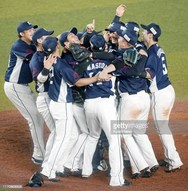 Seibu Lions players celebrate after clinching their pennant victory in Japanese professional baseball's Pacific League for the second straight year...