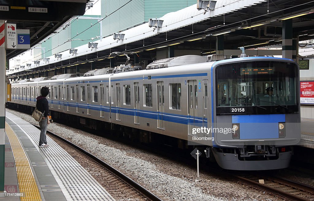 A Seibu Railway Co. train arrives at Nerima Station in Tokyo, Japan, on Monday, June 24, 2013. Cerberus Capital Management LP is battling Seibu Holdings Inc. shareholders including Yoshiaki Tsutsumi, once the world's richest man, for seats on the Japanese company's board. History suggests the investment company, run by Stephen A. Feinberg, will fail. Photographer: Tomohiro Ohsumi/Bloomberg via Getty Images
