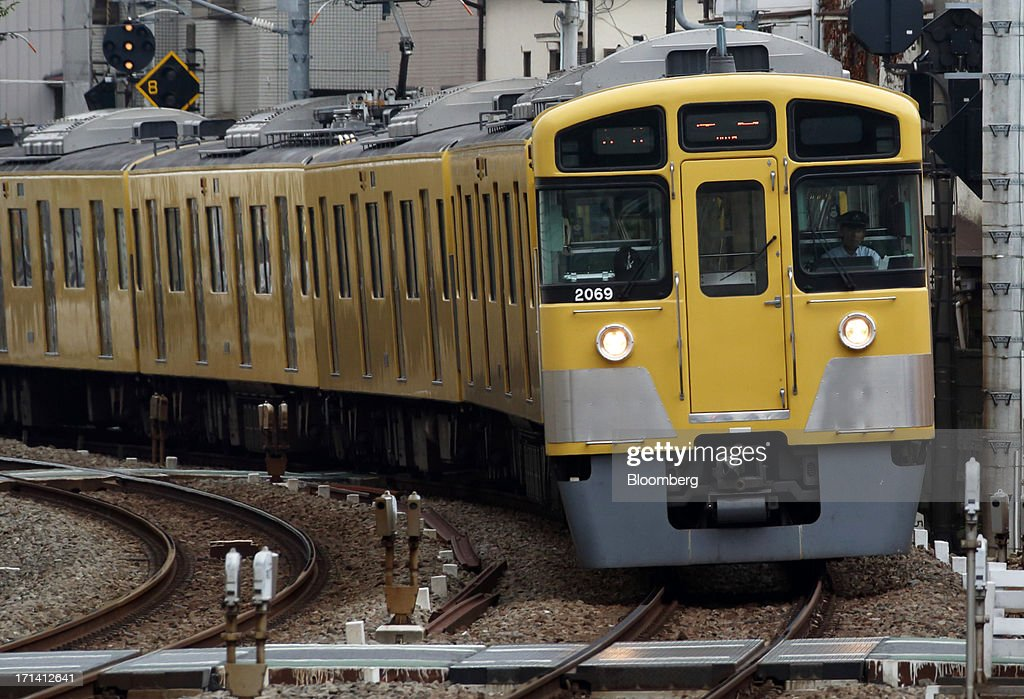 A Seibu Railway Co. train travels near Ikebukuro Station in Tokyo, Japan, on Monday, June 24, 2013. Cerberus Capital Management LP is battling Seibu Holdings Inc. shareholders including Yoshiaki Tsutsumi, once the world's richest man, for seats on the Japanese company's board. History suggests the investment company, run by Stephen A. Feinberg, will fail. Photographer: Tomohiro Ohsumi/Bloomberg via Getty Images