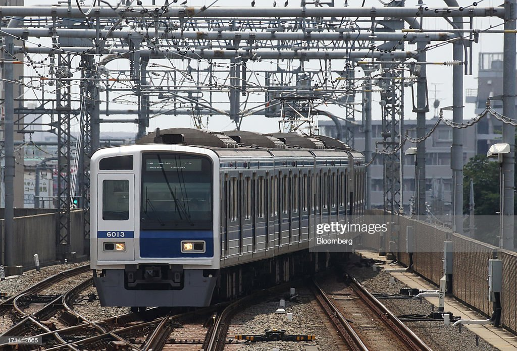 A Seibu Railway Co. train travels near Nerima Station in Tokyo, Japan, on Monday, June 24, 2013. Cerberus Capital Management LP is battling Seibu Holdings Inc. shareholders including Yoshiaki Tsutsumi, once the world's richest man, for seats on the Japanese company's board. History suggests the investment company, run by Stephen A. Feinberg, will fail. Photographer: Tomohiro Ohsumi/Bloomberg via Getty Images