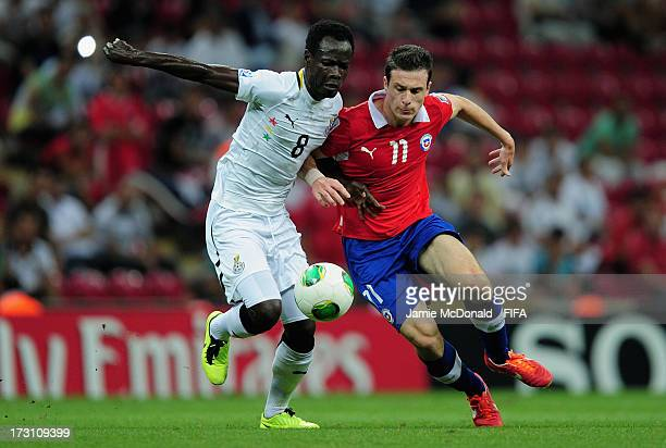 Seidu Salifu of Ghana battles with Angelo Henriquez of Chile during the FIFA U20 World Cup QuarterFinal match between Ghana and Chile at the Ali Sami...