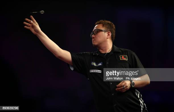 Seigo Asada throws during his match against Gordon mathers during day two of the William Hill World Darts Championship at Alexandra Palace London
