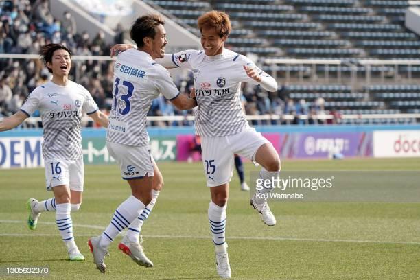 Seigo Kobayashi of Oita Trinita after scoring his side's second goal with team mate during the J.League Meiji Yasuda J1 match between Yokohama FC and...