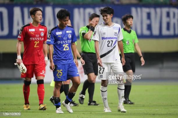 Seigo KOBAYASHI of Oita Trinita and Ryu TAKAO of Gamba Osaka talk after the J.League YBC Levain Cup Group D match between Oita Trinita and Gamba...