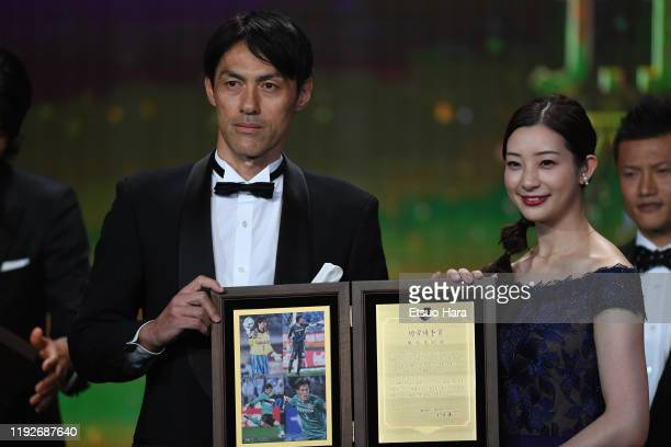 Seigo Narazaki receives Special Service Award from Rika Adachi during the J.League Awards on December 08, 2019 in Tokyo, Japan.