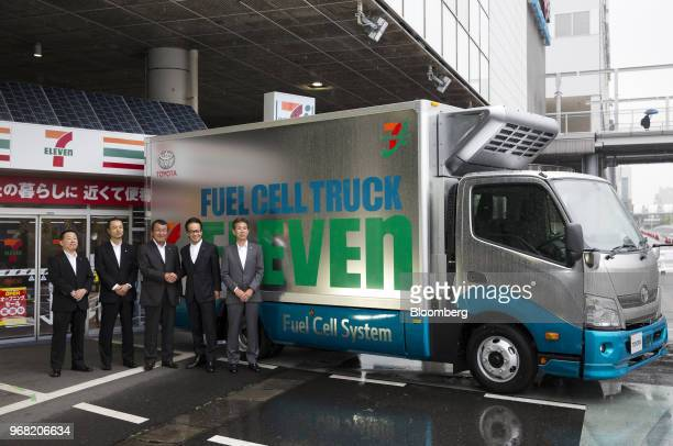 Seiichi Aoyama executive officer of SevenEleven Japan Co from left to right Hisashi Ohashi director and executive officer of SevenEleven Japan Co...
