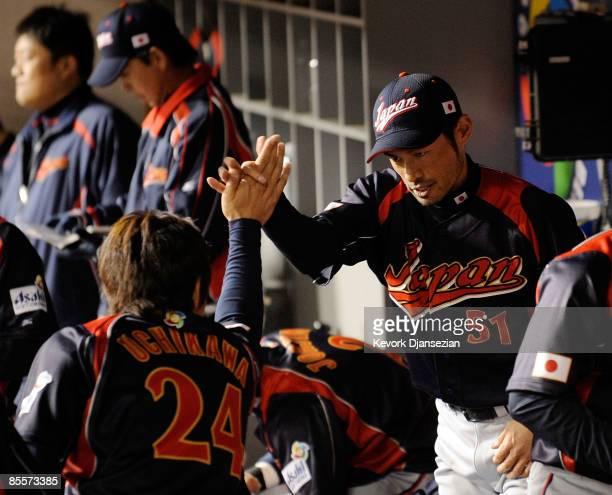 Seiichi Uchikawa and Ichiro Suzuki celebrate after scoring on Suzuki double in the tenth inning of the finals of the 2009 World Baseball Classic on...