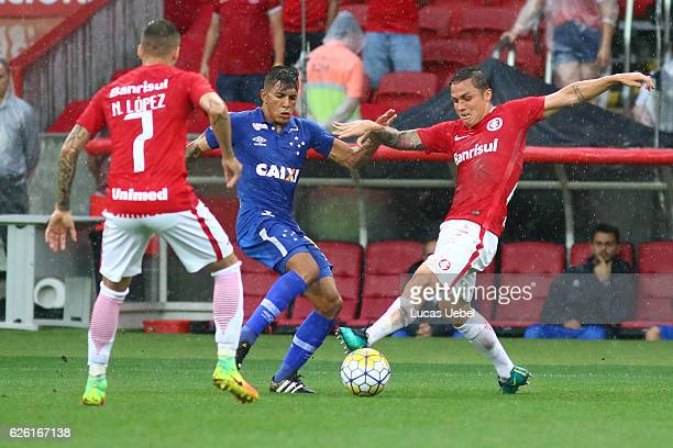 Seijas of Internacional battles for the ball against Lucas Romero of Cruzeiro during the match between Internacional and Cruzeiro as part of...