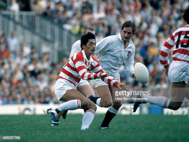 Seiji Hirao of Japan releases the ball watched by Gary Rees of England during the International match between England and Japan at Twickenham in...