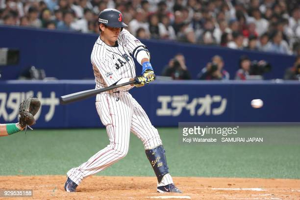 Seiji Kobayashi of Japan bats during the game one of the baseball international match between Japan And Australia at the Nagoya Dome on March 3 2018...