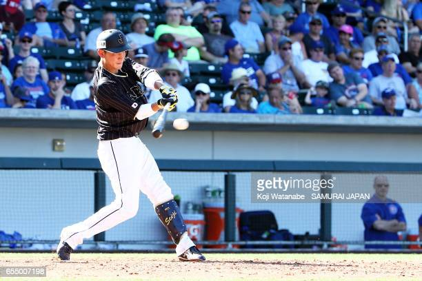 Seiji Kobayashi of Japan hits a single in the top half of the eigth inning during the exhibition game between Japan and Chicago Cubs at Sloan Park on...