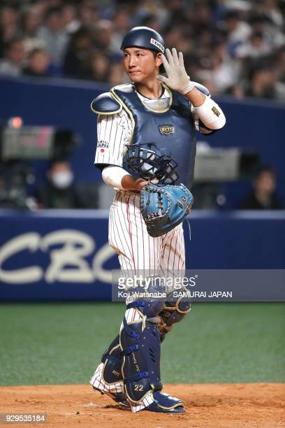 Seiji Kobayashi of Japan responds during the game one of the baseball international match between Japan And Australia at the Nagoya Dome on March 3...
