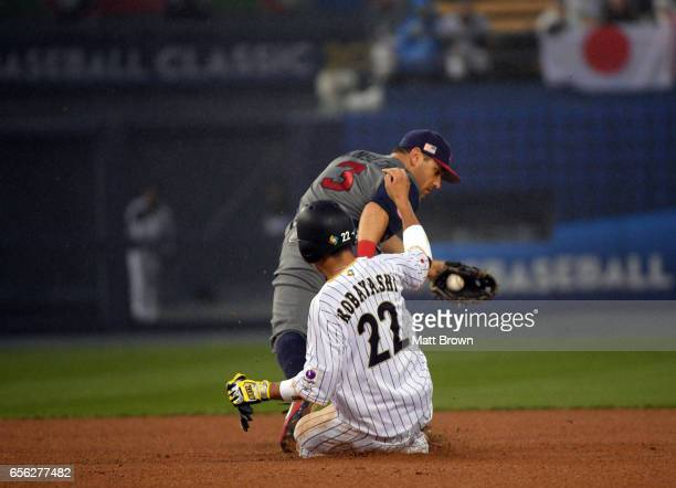 Seiji Kobayashi of Team Japan is out at second as Ian Kinsler of Team USA makes the play in the bottom of the second inning of Game 2 of the...