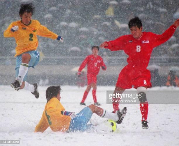 Seiji Koga of Higashi Fukuoka and Kazunobu Obara of Teikyo compete for the ball during the 76th All Japan High School Soccer Tournament Final between...